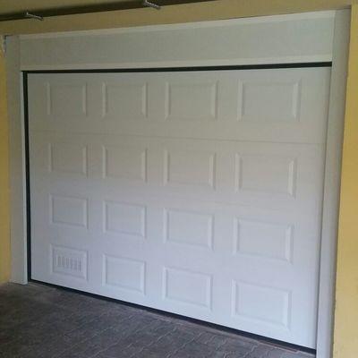 Puerta de garaje seccional en cuarterón