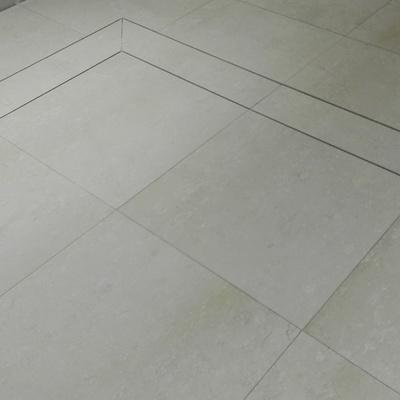 Obra maestra alfombra de marmol con junquillo de latón