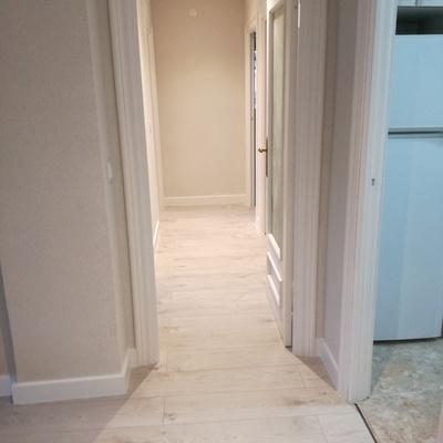 Quitar tabiques ,lacado de puertas y ystalacion de suelo laminado.
