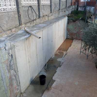 Muro contención más hormigón