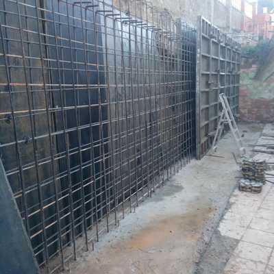 Muro contención más hierro