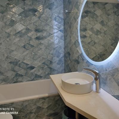 Baño azulejo combinado con dekton