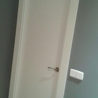 Puerta dormitorio 1.
