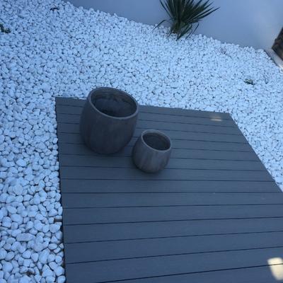 Acondicionamiento terraza, zona entarimada y bolo blanco