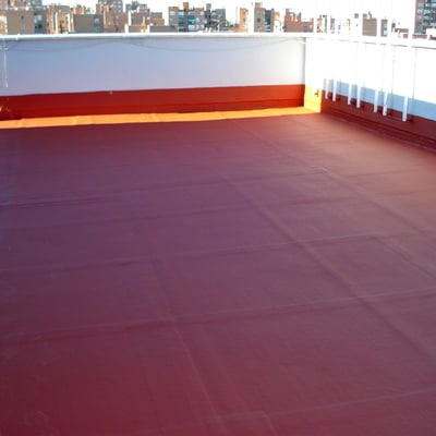 impermeabilizacion en terraza con caucho rojo teja a modo de sanwichese con malle de fibra de vidrio entre capa y capa