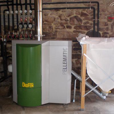 Instalación de Caldera de Biomasa y Energía Solar Térmica