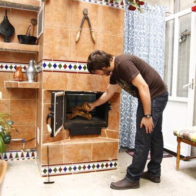Instalación de chimenea de leña calefactora para la calefacción por agua