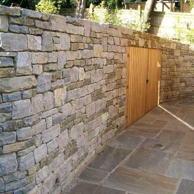 Muro de piedra en Chale de lujio
