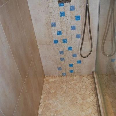 ducha y detalles obra