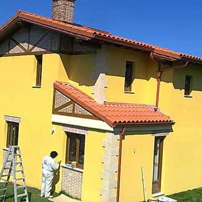 pintura de fachadas revetón rugoso amarillo
