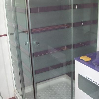 Plato de ducha con mampara