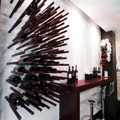 Proyecto de Restaurante Italiano en Sitges_Detalle Botellero en Recepción