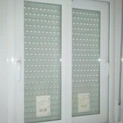 Puerta Aluminio y persiana