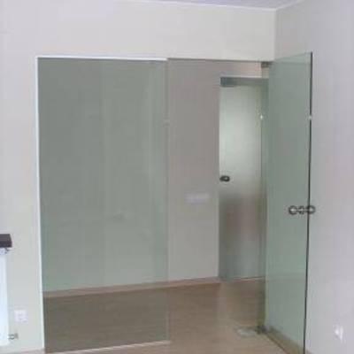 puerta de vidrio vaivén con fijo lateral