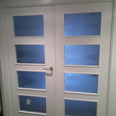Puerta doble lacada blanco con cristales