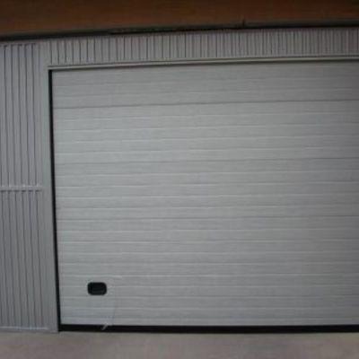 Puerta seccional comunitaria Ral 9006