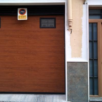 puertas seccionables motorizadas y puertas tht de entrada