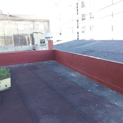 Reconstrucción de muro de terraza.
