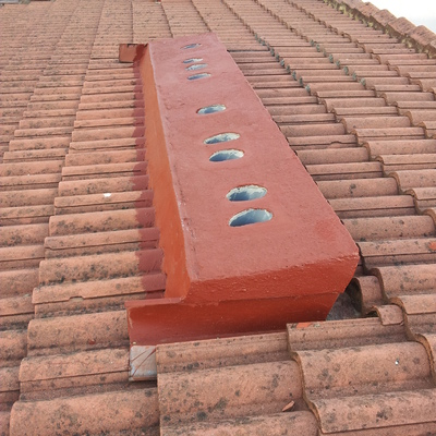 Reconstrucción e impermeabilización de chimenea (después).