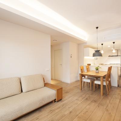 Espacio abierto que alberga salón, comedor y cocina | Sincro