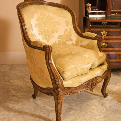 Sillón clásico tapizado