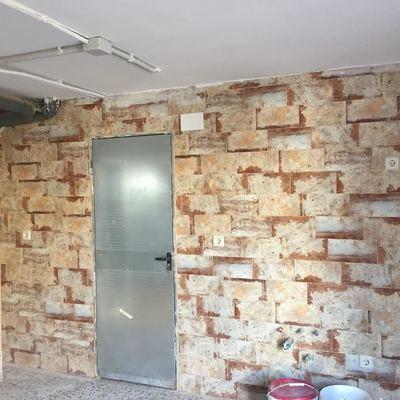 Alicatado de una pared en un garaje