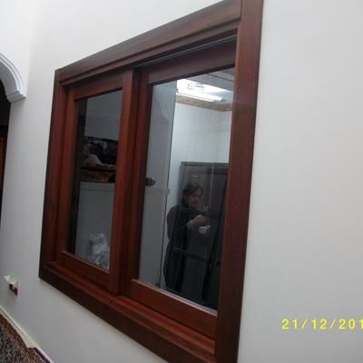 Presupuesto ventanas corredera online habitissimo for Ventanas pvc color madera