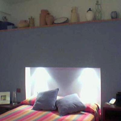 Vivienda unifamiliar en bloque sita en Sevilla. Cabecero obra