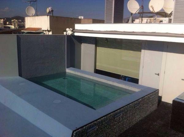 Foto construcci n piscina en tico de barcelona de for Piscinas para enterrar precios
