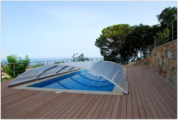 Foto piscina con cobertor de construcciones stan lloret for Precio cobertor piscina