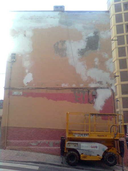 fachada cominidad de vecinos del zapillo sin pintar