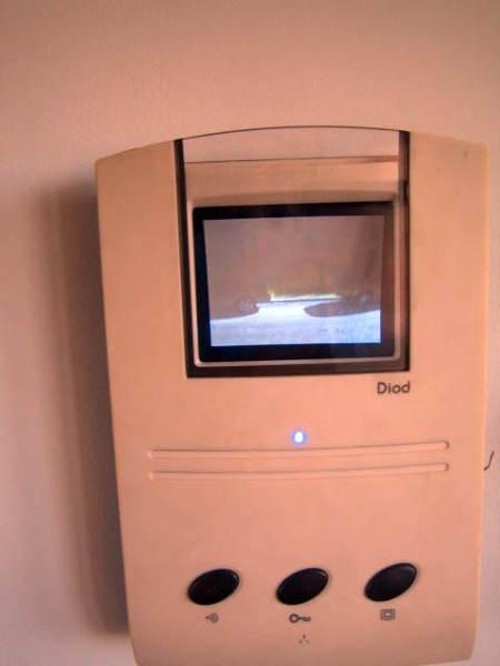 Foto intercomunicador video tel fono de la puerta de aron for Puertas kiuso telefono