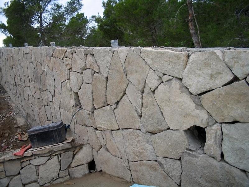 foto muro de piedra de obras y reformas casadecor 149237