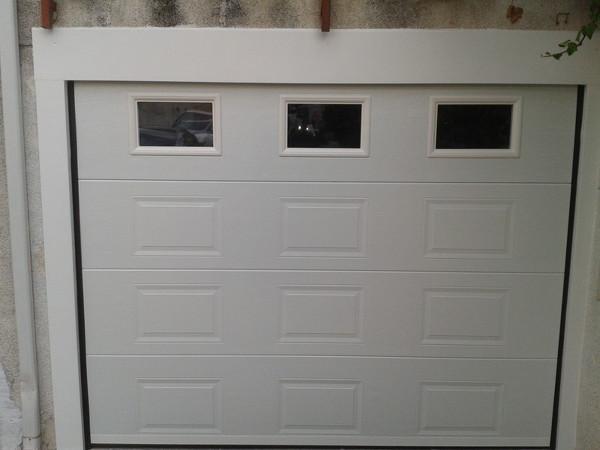 Foto puerta seccional cuarteron y ventanas de josecu 521703 habitissimo - Puertas de garaje seccionales baratas ...
