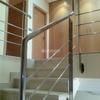 Escalera para buhardilla en un duplex