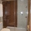 Reformar el baño: alicatado, ventana y ducha