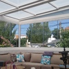Cierre de cortina de cristal con techo transparente que deje pasar la luz trabajo en terraza de ático 4 planta