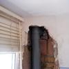 Arreglar bajante suelta en la fachada
