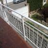 Proyectar poliuretano más pintura de protección en fachada medianera por el exterior