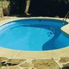 Cambiar bordillo piscina y pegar piedras fachada