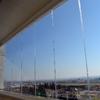 Cortina de cristal sin perfiles para balcón
