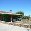Sanear y reforzar paredes de piedra y tejado de una casa de 8m x 4m de planta
