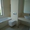 Realizar baño de minusválidos en local