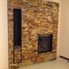 Retirar hiedra y hacer muro con revestimiento piedra, de separación patios