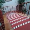 Enmoquetar escalera y pasillo