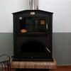 Instalar estufa de leña y radiadores