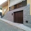 Forrar muro exterior con piedra llica de vall