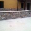 Instalar valla metalica cerrada encima de muro de piedra
