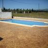 Instalar terraza de hormigon impreso en zona actual de sesped