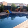Hormigon impreso  rodeando piscina